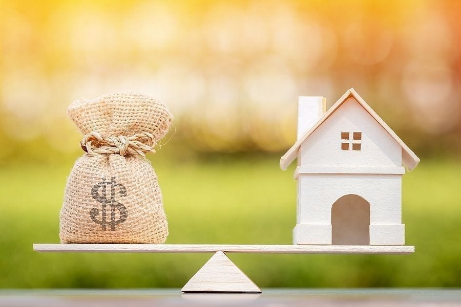 Home loan refinance,Home And Money Bag Put On The Scales With Balance,refinancing my home loan,