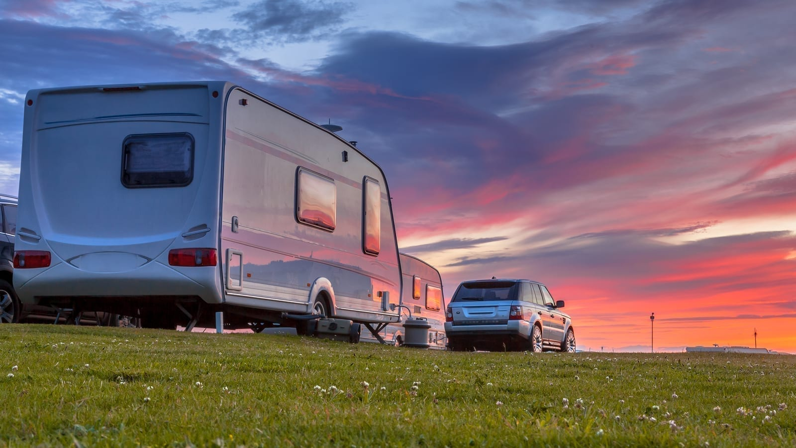 caravan loan calculator, Camping caravans and cars parked on a grassy campground under beautiful sunset, caravan finance, camper loans, gold coast caravan finance, new caravans loan, used caravan credit, private sale, dealer, rv, camping, leisure, lifestyle, camping, travelling, road, roadway, campsite,caravan park,